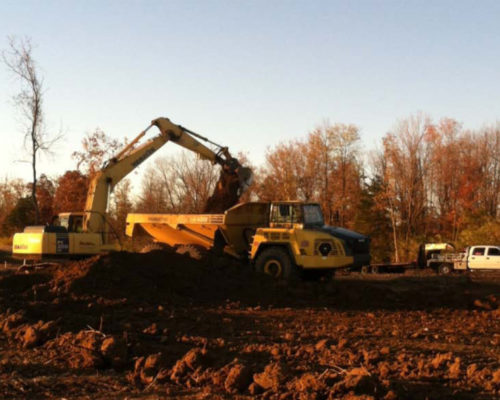 excavator sunset